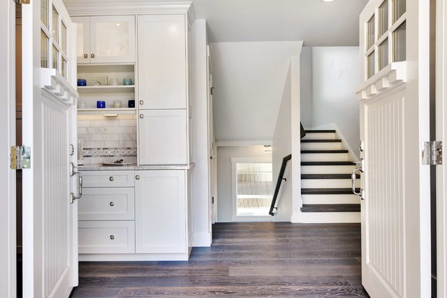 Small transitional medium tone wood floor entryway photo in Seattle with white walls and a white front door