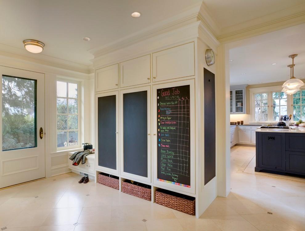Entryway - traditional beige floor entryway idea in Seattle with a glass front door