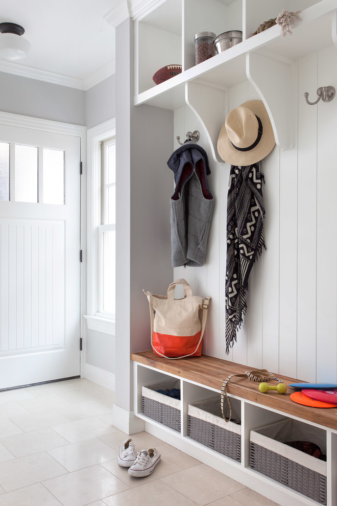 Entryway - traditional entryway idea in Austin with gray walls and a white front door