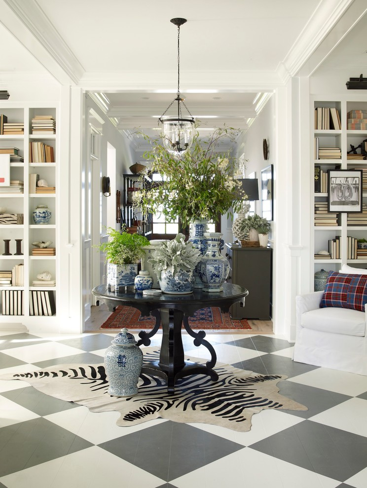 Example of a coastal multicolored floor foyer design in San Diego with white walls