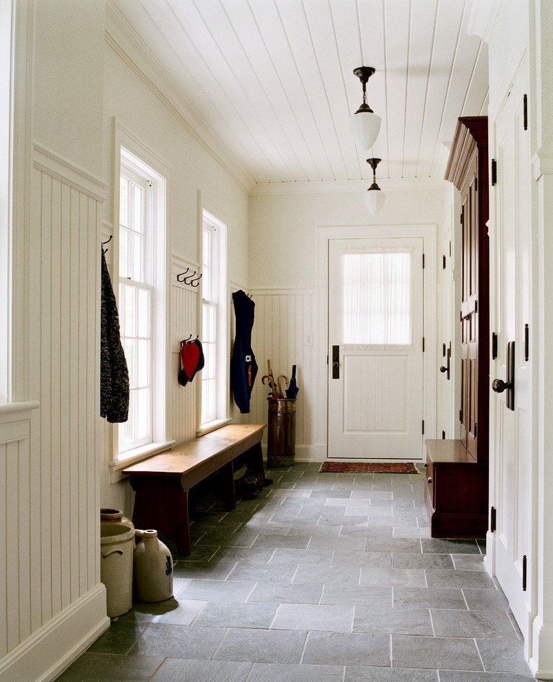 Inspiration for a mid-sized timeless slate floor and black floor entryway remodel in Boston with white walls and a white front door