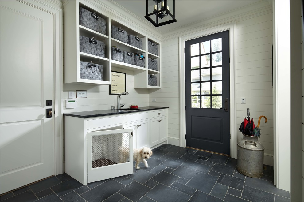 Elegant gray floor entryway photo in Minneapolis with white walls and a black front door