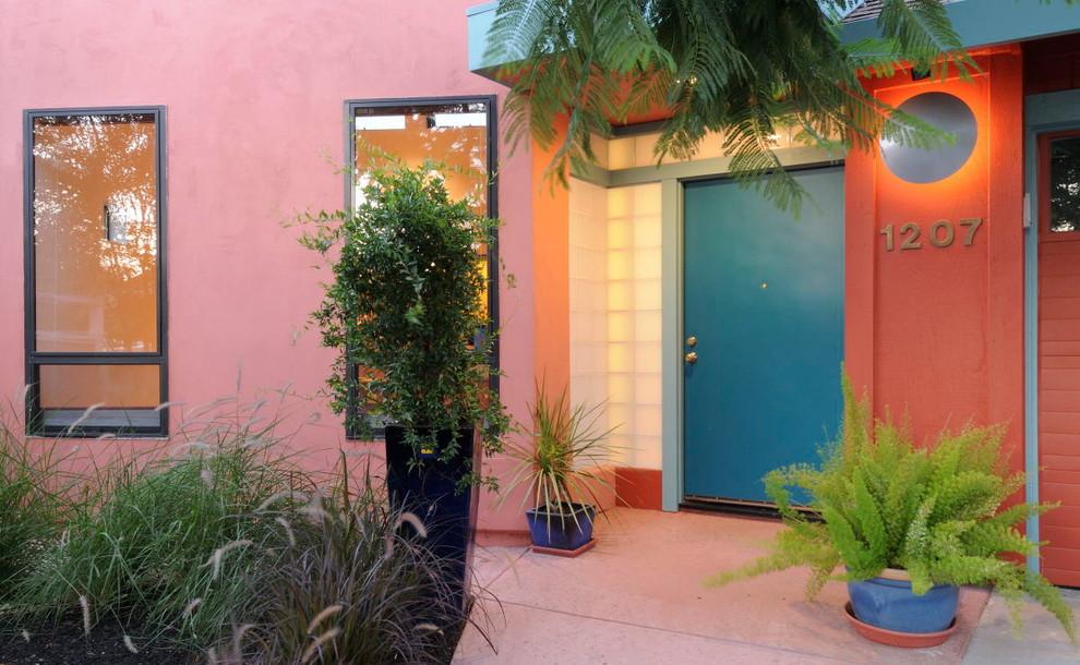 Entryway - eclectic entryway idea in Sacramento with a blue front door