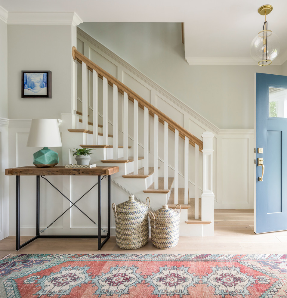 Inspiration for a country light wood floor and beige floor foyer remodel in Boston with gray walls and a blue front door