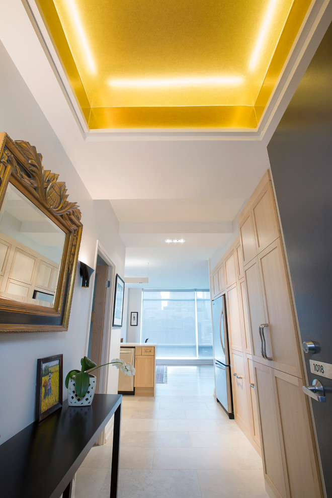 Inspiration for a small transitional porcelain tile foyer remodel in Toronto with gray walls