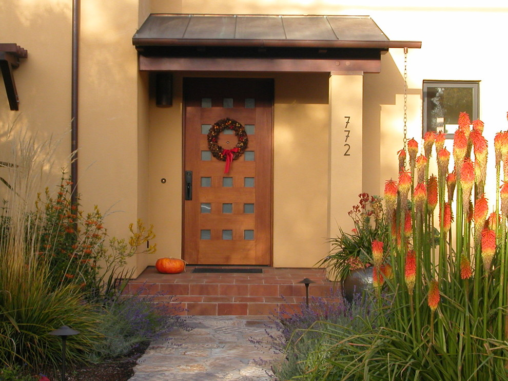 Inspiration for a contemporary entryway remodel in San Francisco with a medium wood front door