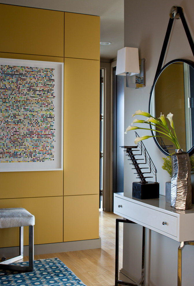 Mid-sized trendy light wood floor foyer photo in Boston with yellow walls