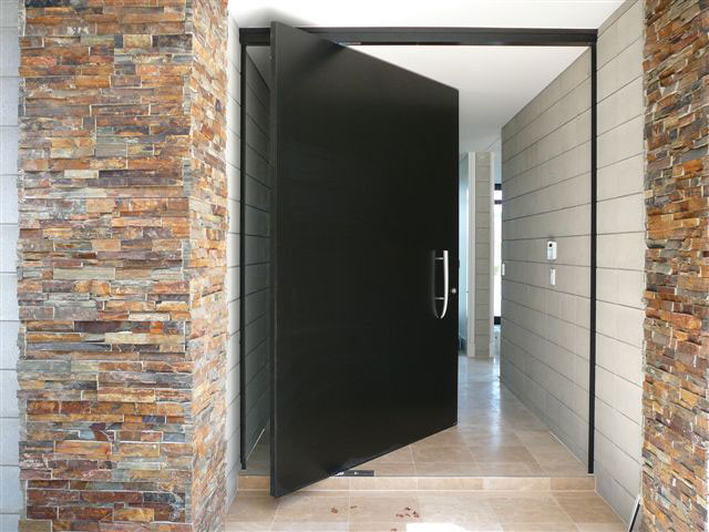 Pivot doors contemporary entry orange county by for Oversized exterior doors