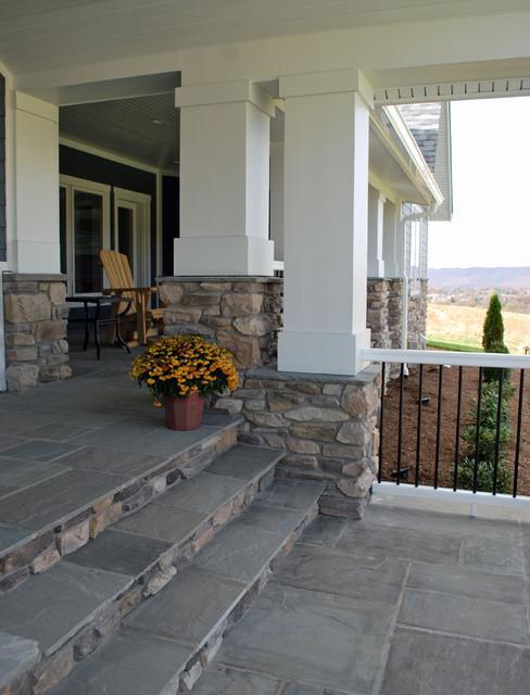 Contemporary farmhouse stone pillar porch traditional for Eldorado stone outdoor kitchen cabinet