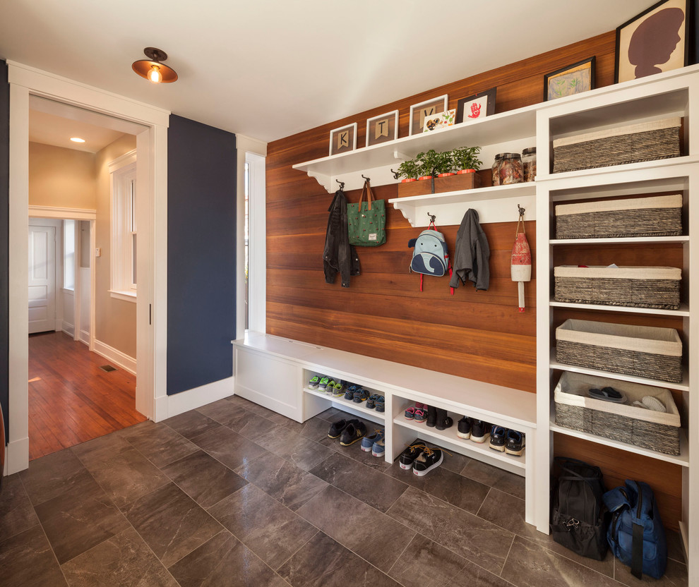 Small transitional porcelain tile mudroom photo in Cincinnati with blue walls