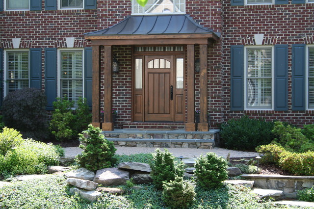 Copper portico with custom cedar door and matching columns for Portico entrance with columns