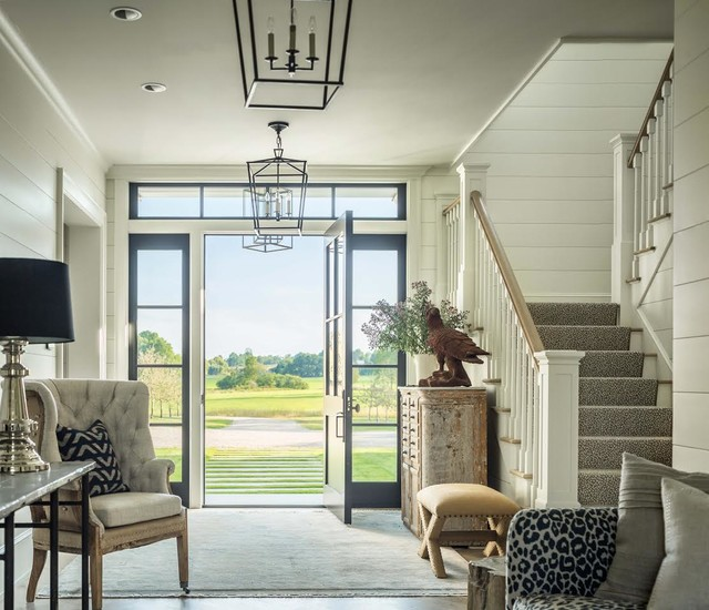 Entryway - country entryway idea in Burlington with white walls and a black front door
