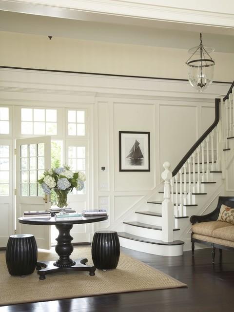 Elegant foyer photo in New York with white walls