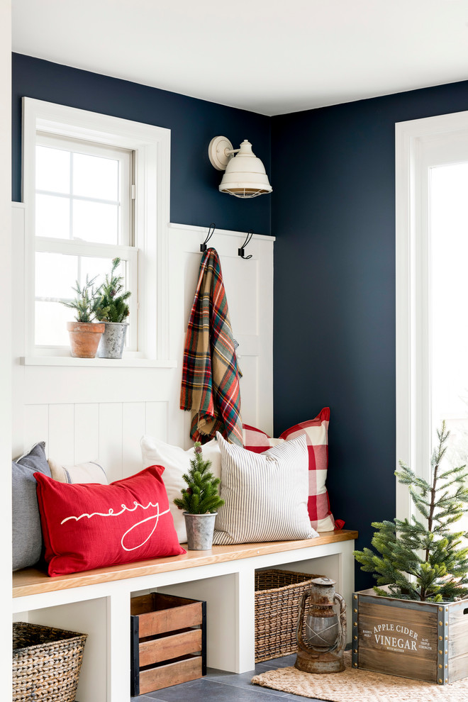 Entryway - mid-sized country gray floor entryway idea in Minneapolis with blue walls and a white front door