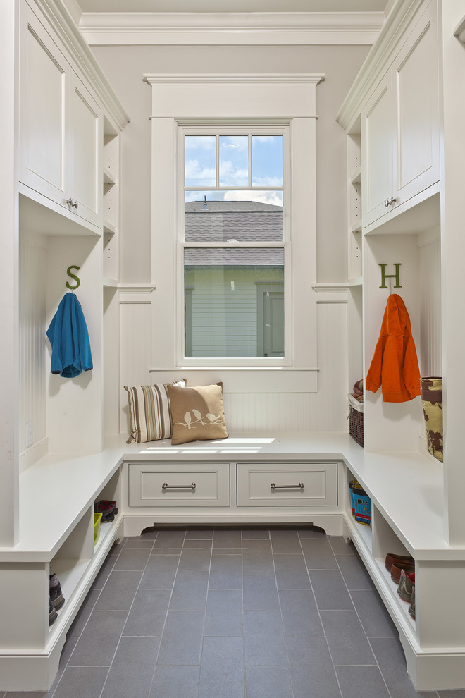 Inspiration for a timeless gray floor mudroom remodel in Houston with gray walls