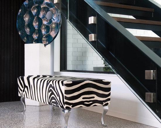 Cowhide zebra ottoman with Queen Anne legs - This amazing bench ottoman is covered in a printed cowhide zebra skin. Made by Gorgeous Creatures in New Zealand.