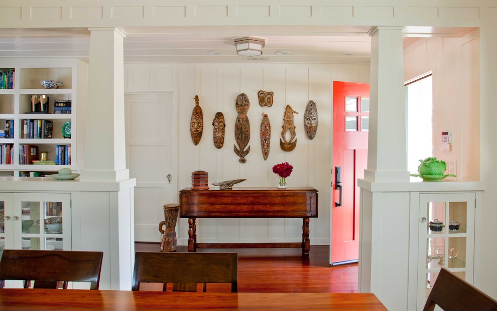 Mid-sized elegant dark wood floor and brown floor entryway photo in San Diego with a red front door and white walls