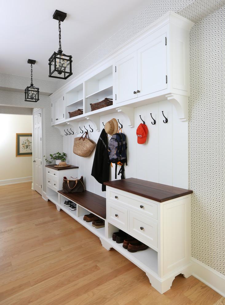 Mudroom - traditional light wood floor and beige floor mudroom idea in Philadelphia with multicolored walls