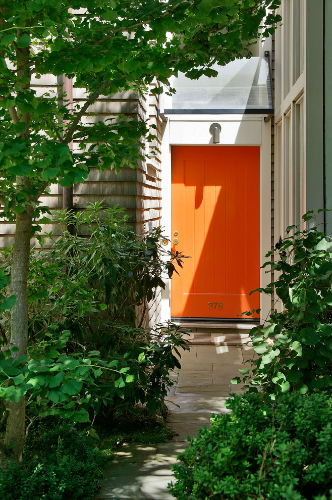 Inspiration for an eclectic entryway remodel in San Francisco with an orange front door