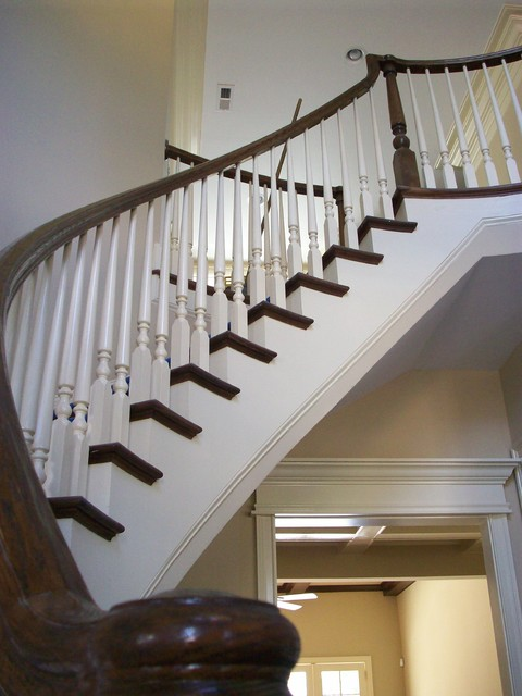 Curved Staircase traditional entry