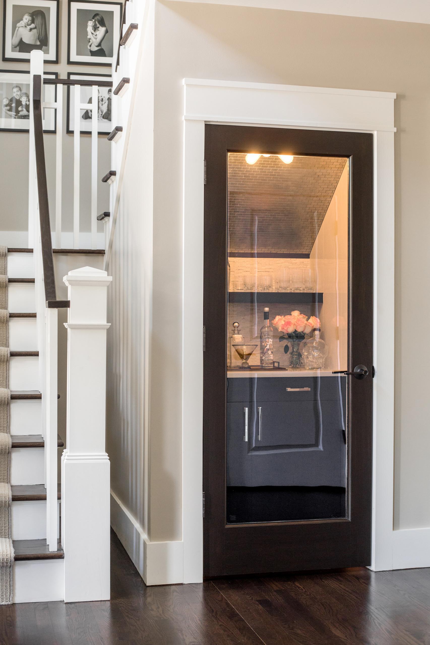 Entryway - small contemporary dark wood floor entryway idea in Detroit with beige walls and a dark wood front door