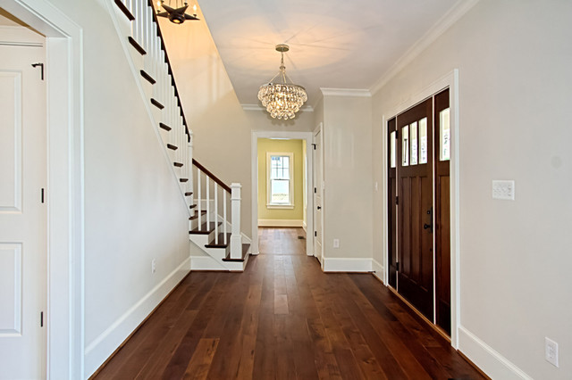 Custom dark stained hickory flooring traditional entry for Hardwood floor dealers