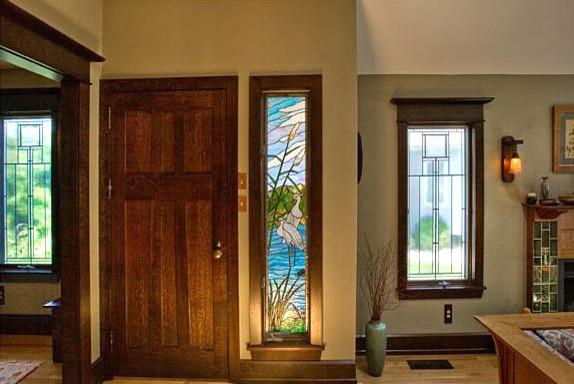 Custom door in quartered white oak with adjacent door ...