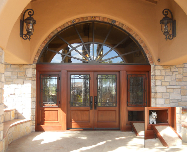 Custom Entry System With Concealed Dog Door Mediterranean Entry