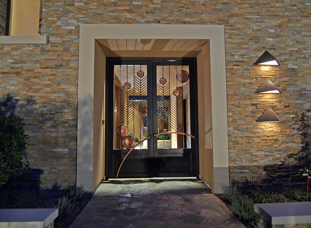Inspiration for a large contemporary slate floor entryway remodel in Las Vegas