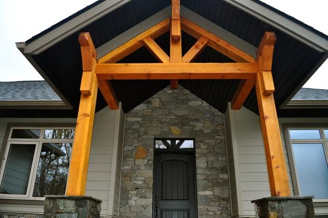 Custom timber frame hybrid traditional entry for Ranch timber frame plans