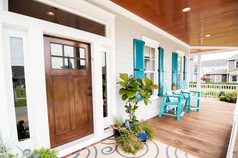 Beach style medium tone wood floor entryway photo in Other with gray walls and a medium wood front door