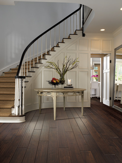 Dark Hand Scraped Wood Entry With White Paneling