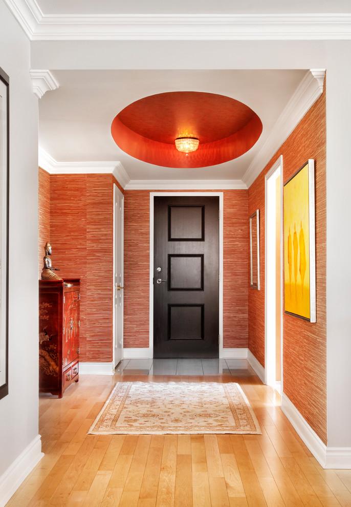 Huge asian light wood floor entryway photo in Toronto with red walls and a dark wood front door