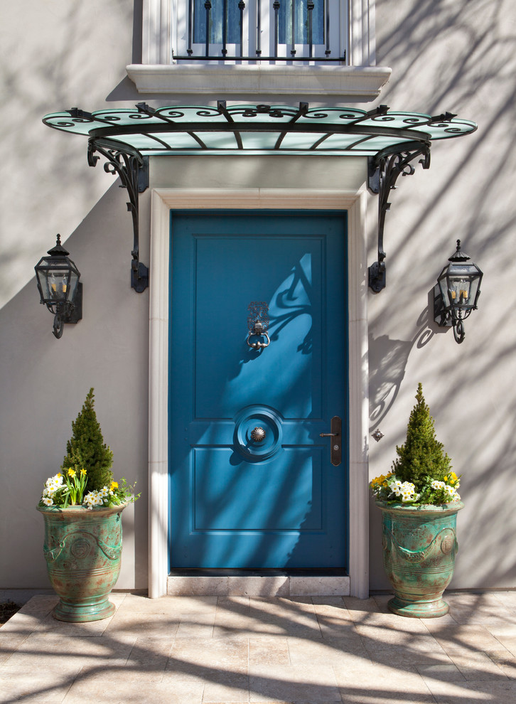 Inspiration for a large timeless entryway remodel in Denver with a blue front door and gray walls