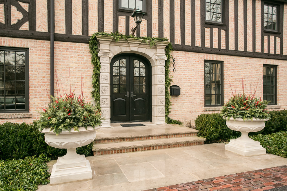 Inspiration for a large timeless double front door remodel in Chicago with a black front door