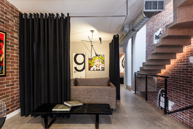Example Of A Trendy Concrete Floor Entryway Design In Other