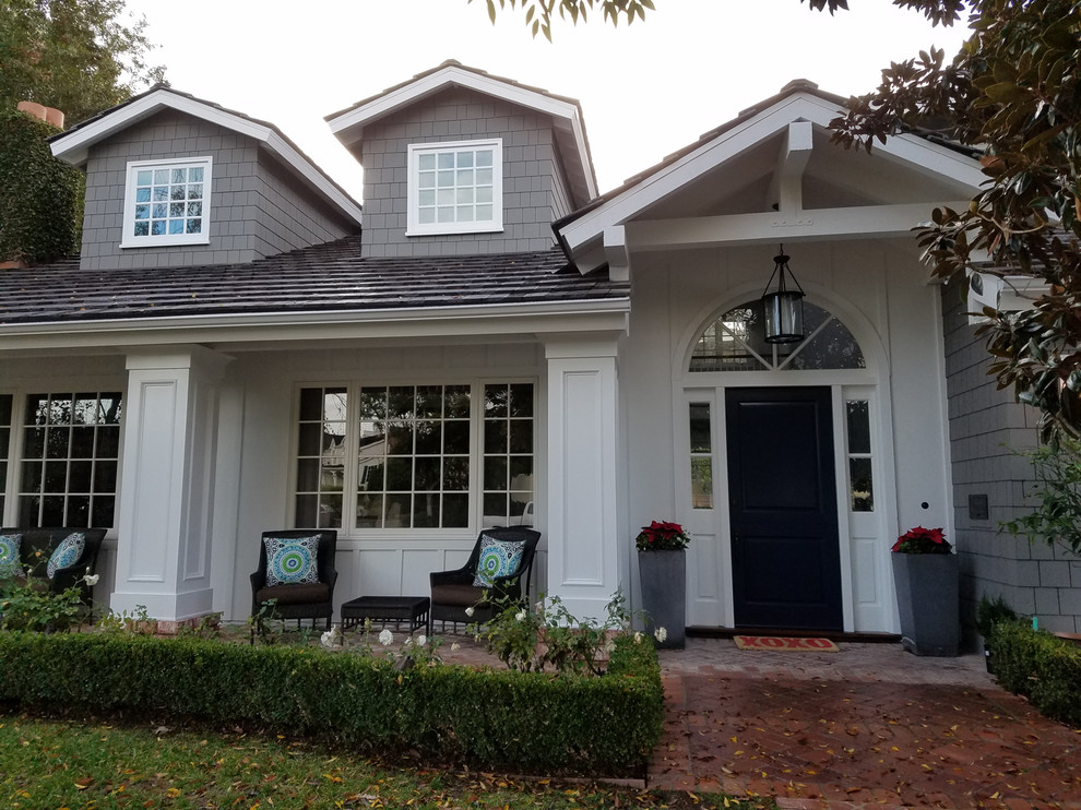 Inspiration for a mid-sized dutch front door remodel in Orange County with a black front door