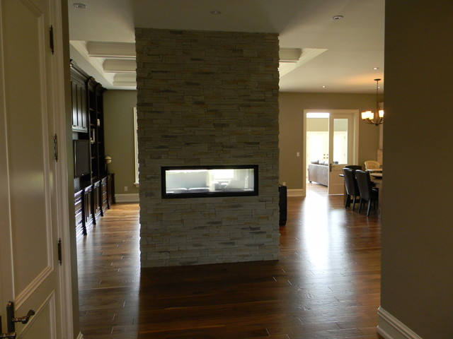 Double sided gas fireplace in bungalow entry toronto for Double sided fireplace design