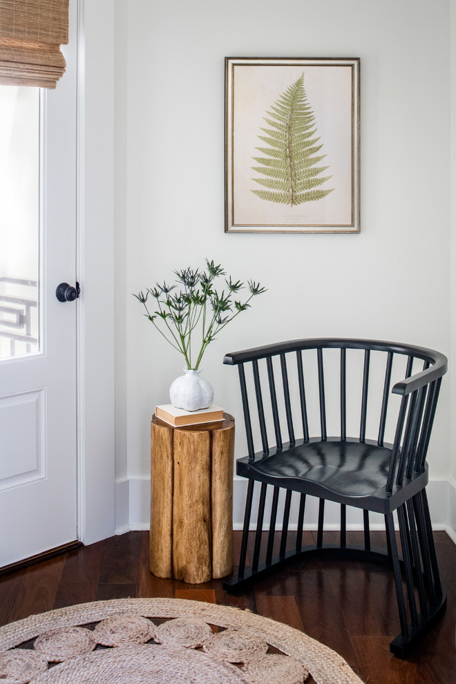 Inspiration for a small coastal medium tone wood floor and red floor entryway remodel in Other with white walls and a gray front door