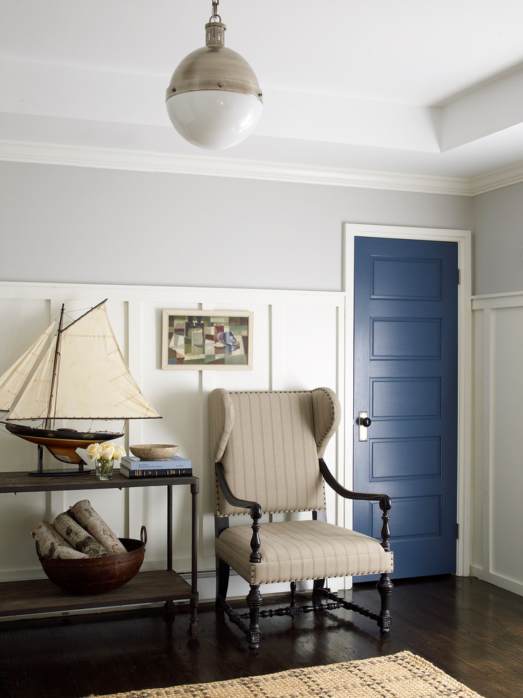 Inspiration for a coastal black floor entryway remodel in New York with a blue front door