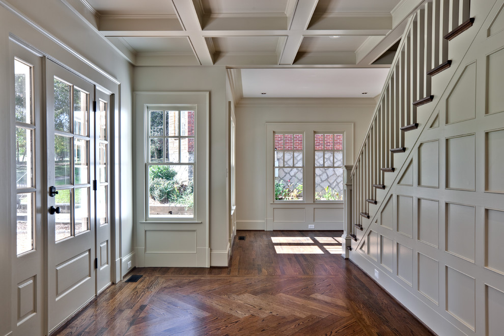 Example of a classic dark wood floor entryway design in Atlanta with white walls