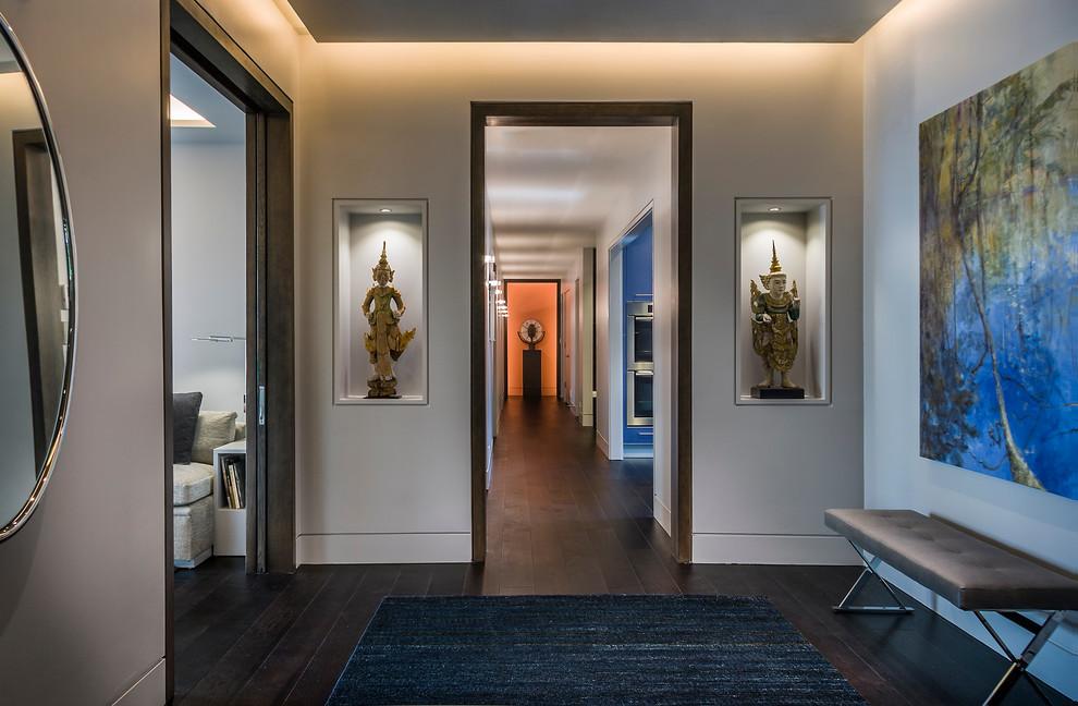 Entryway - contemporary dark wood floor entryway idea in Chicago with gray walls