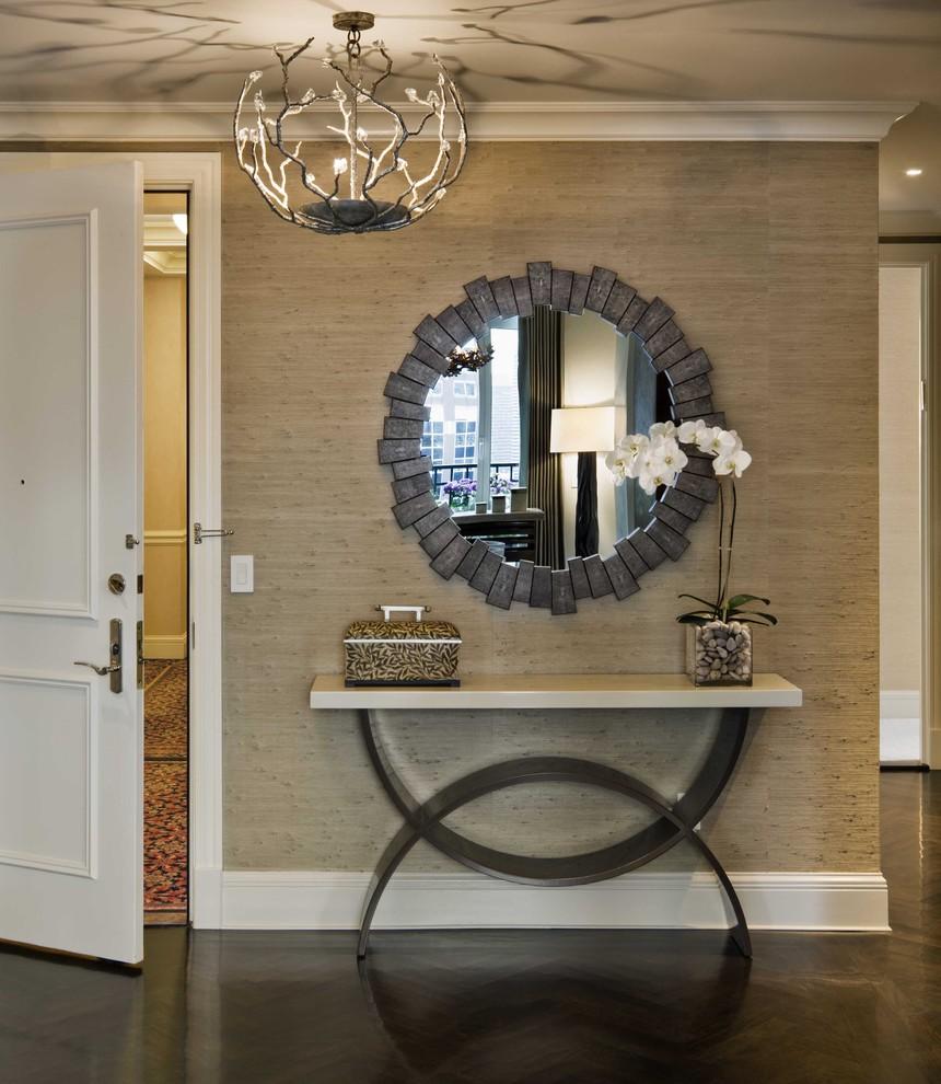 Transitional dark wood floor entryway photo in New York with beige walls