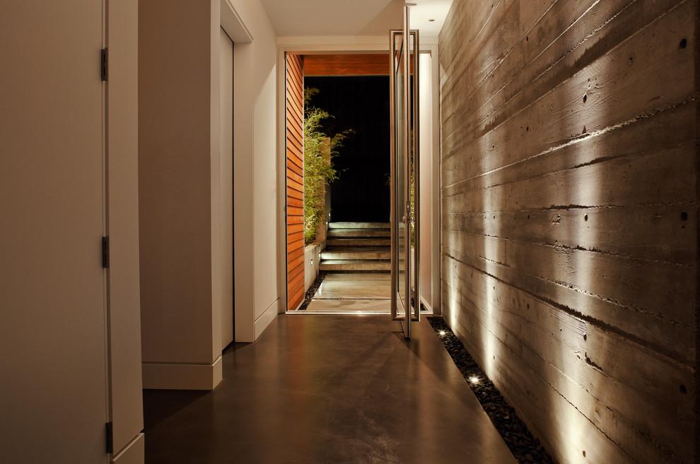 Minimalist concrete floor pivot front door photo in Vancouver with a glass front door