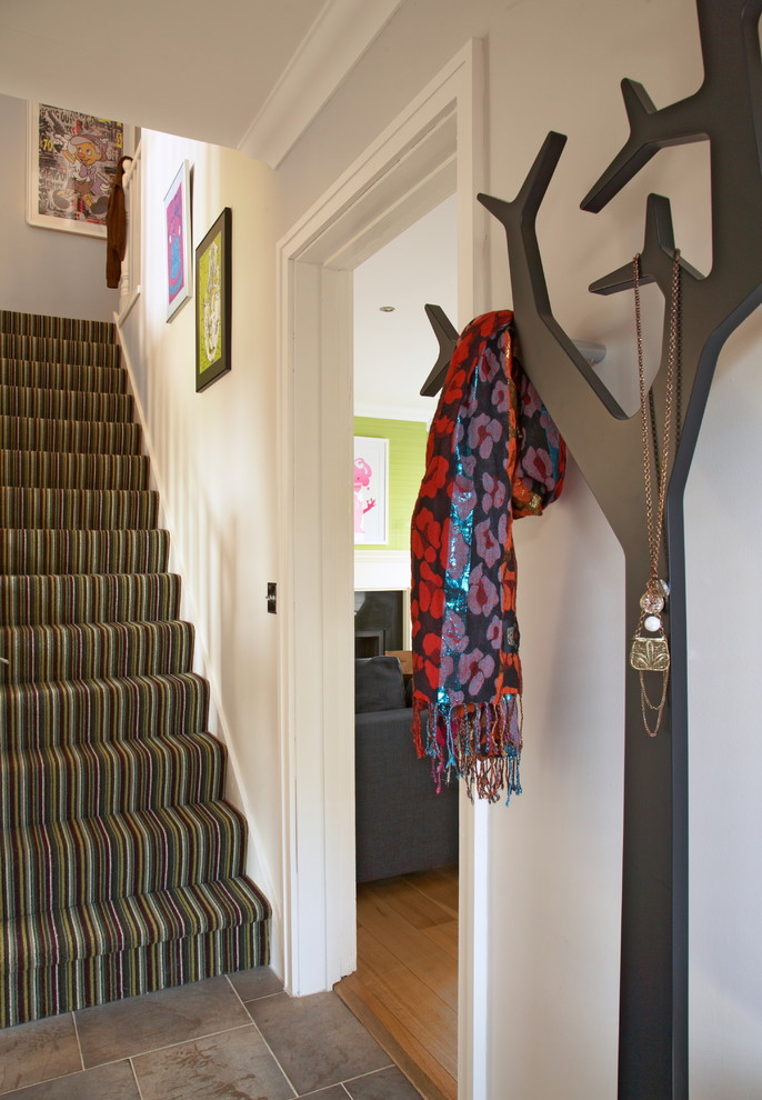Entryway - eclectic entryway idea in Dublin with gray walls