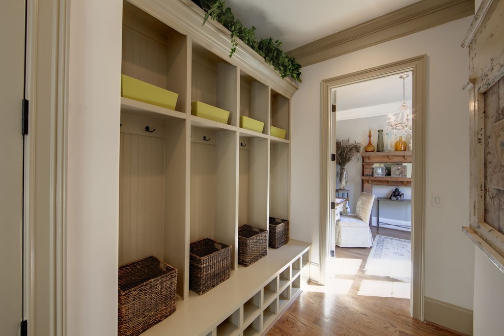 Elegant mudroom photo in Charlotte with beige walls