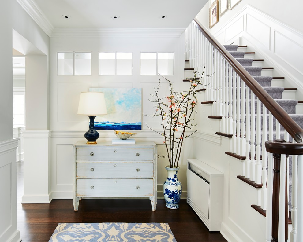 Example of a mid-sized classic dark wood floor foyer design in Minneapolis with white walls and a white front door