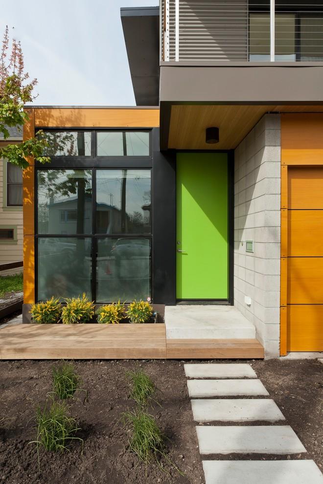 Example of a trendy single front door design in San Francisco with a green front door