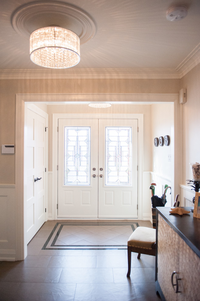 Example of a transitional entryway design in Toronto with beige walls and a glass front door