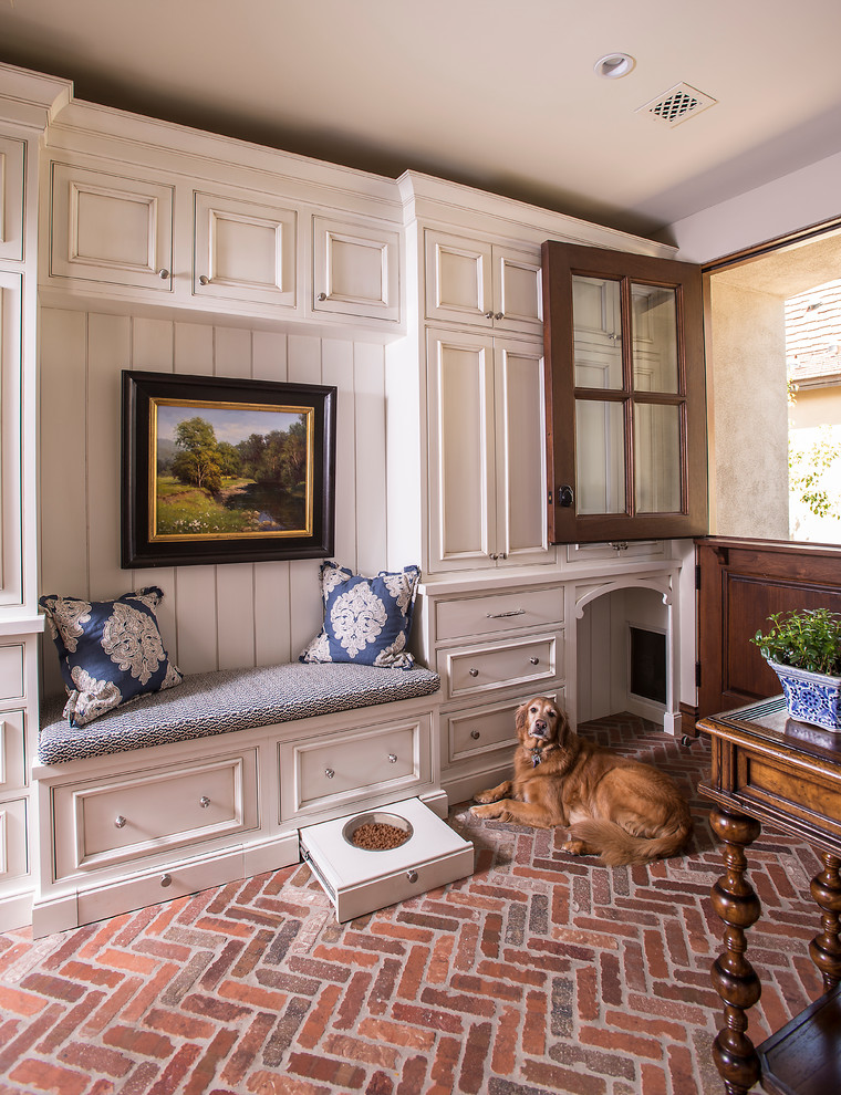 Inspiration for a timeless brick floor entryway remodel in Phoenix with a dark wood front door